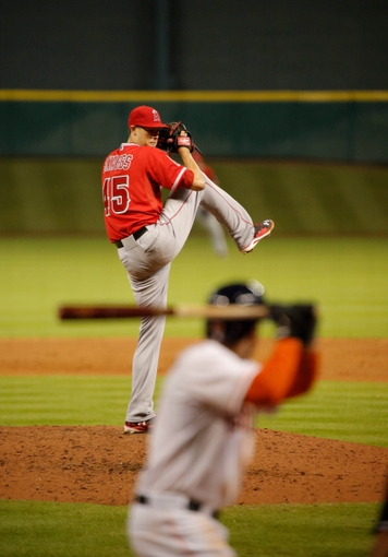 Apr 5, 2014; Houston, TX, USA; Los Angeles Angels starting pitcher Tyler Skaggs (45) pitches during the sixth inning against the Houston Astros at Minute Maid Park. Mandatory Credit: Andrew Richardson-USA TODAY Sports