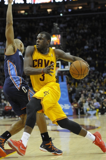 Apr 5, 2014; Cleveland, OH, USA; Cleveland Cavaliers guard Dion Waiters (3) dribbles the ball around Charlotte Bobcats guard Gerald Henderson (9) in the third quarter at Quicken Loans Arena. Mandatory Credit: David Richard-USA TODAY Sports