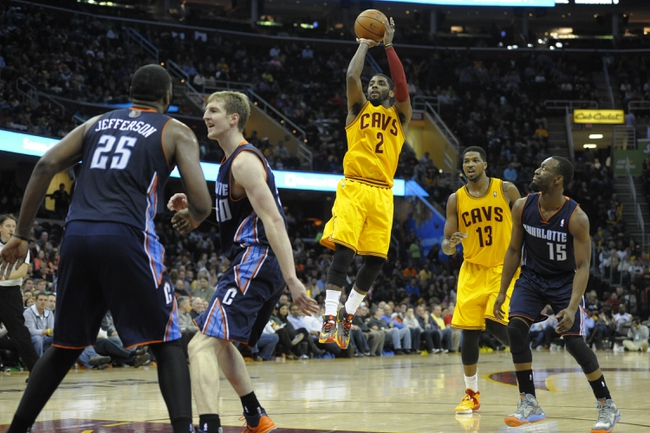 Apr 5, 2014; Cleveland, OH, USA; Cleveland Cavaliers guard Kyrie Irving (2) shoots the ball against the Charlotte Bobcats in the third quarter at Quicken Loans Arena. Mandatory Credit: David Richard-USA TODAY Sports