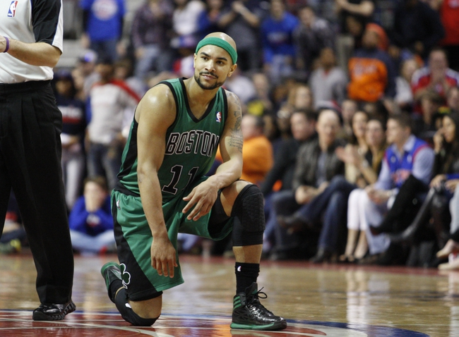 Apr 5, 2014; Auburn Hills, MI, USA; Boston Celtics guard Jerryd Bayless (11) takes a knee after missing a three point shot during the fourth quarter against the Detroit Pistons at The Palace of Auburn Hills. Pistons beat the Celtics 115-111. Mandatory Credit: Raj Mehta-USA TODAY Sports