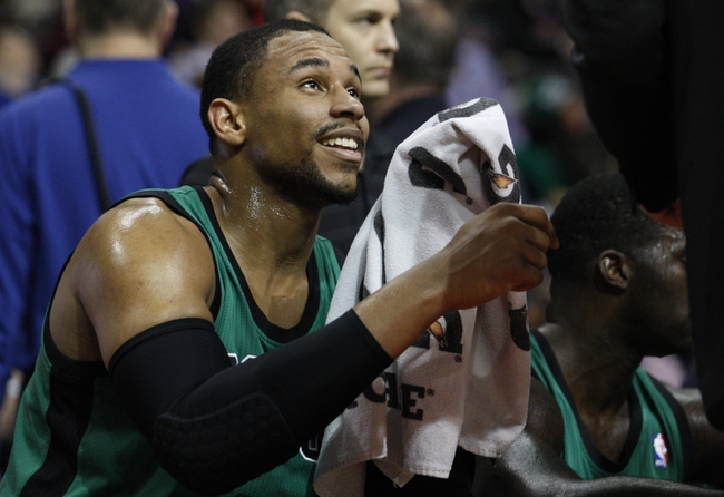 Apr 5, 2014; Auburn Hills, MI, USA; Boston Celtics center Jared Sullinger (7) smiles on the bench during the third quarter against the Detroit Pistons at The Palace of Auburn Hills. Pistons beat the Celtics 115-111. Mandatory Credit: Raj Mehta-USA TODAY Sports