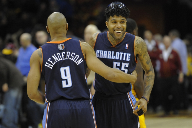Apr 5, 2014; Cleveland, OH, USA; Charlotte Bobcats guard Chris Douglas-Roberts (55) celebrates with guard Gerald Henderson (9) after defeating the Cleveland Cavaliers 96-94 in overtime at Quicken Loans Arena. Mandatory Credit: David Richard-USA TODAY Sports