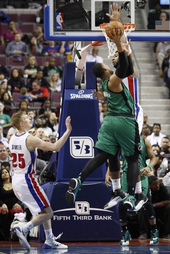 Apr 5, 2014; Auburn Hills, MI, USA; Boston Celtics center Jared Sullinger (7) has his shot blocked by Detroit Pistons center Andre Drummond (0) during the fourth quarter at The Palace of Auburn Hills. Pistons beat the Celtics 115-111. Mandatory Credit: Raj Mehta-USA TODAY Sports