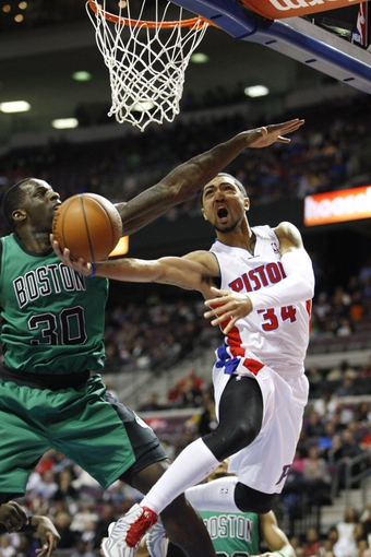 Apr 5, 2014; Auburn Hills, MI, USA; Detroit Pistons guard Peyton Siva (34) takes a shot against Boston Celtics forward Brandon Bass (30) during the fourth quarter at The Palace of Auburn Hills. Pistons beat the Celtics 115-111. Mandatory Credit: Raj Mehta-USA TODAY Sports