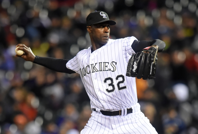 Apr 5, 2014; Denver, CO, USA; Colorado Rockies relief pitcher LaTroy Hawkins (32) pitches in the ninth inning against the Arizona Diamondbacks at Coors Field. The Rockies defeated the Diamondbacks 9-4. Mandatory Credit: Ron Chenoy-USA TODAY Sports