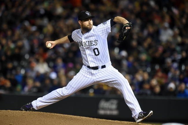 Apr 5, 2014; Denver, CO, USA; Colorado Rockies relief pitcher Adam Ottavino (0) pitches in the seventh inning against the Arizona Diamondbacks at Coors Field. The Rockies defeated the Diamondbacks 9-4. Mandatory Credit: Ron Chenoy-USA TODAY Sports