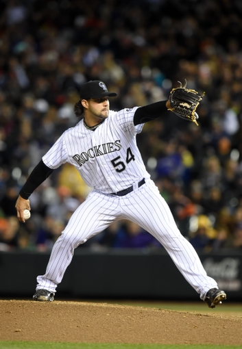 Apr 5, 2014; Denver, CO, USA; Colorado Rockies relief pitcher Tommy Kahnle (54) pitches in the sixth inning against the Arizona Diamondbacks at Coors Field. The Rockies defeated the Diamondbacks 9-4. Mandatory Credit: Ron Chenoy-USA TODAY Sports