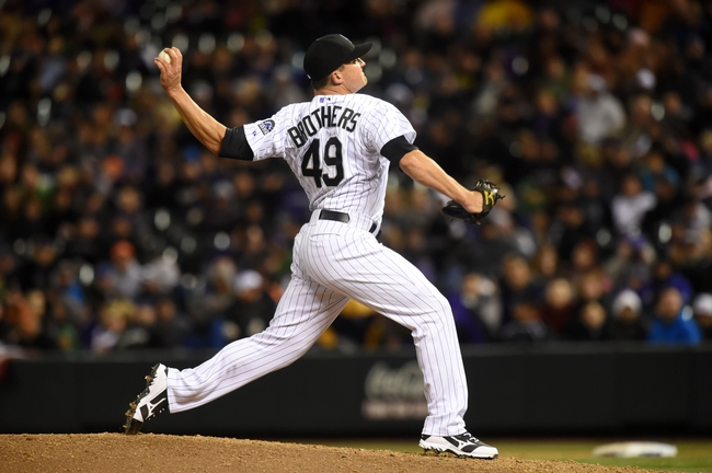 Apr 5, 2014; Denver, CO, USA; Colorado Rockies relief pitcher Rex Brothers (49) pitches in the eighth inning against the Arizona Diamondbacks at Coors Field. The Rockies defeated the Diamondbacks 9-4. Mandatory Credit: Ron Chenoy-USA TODAY Sports