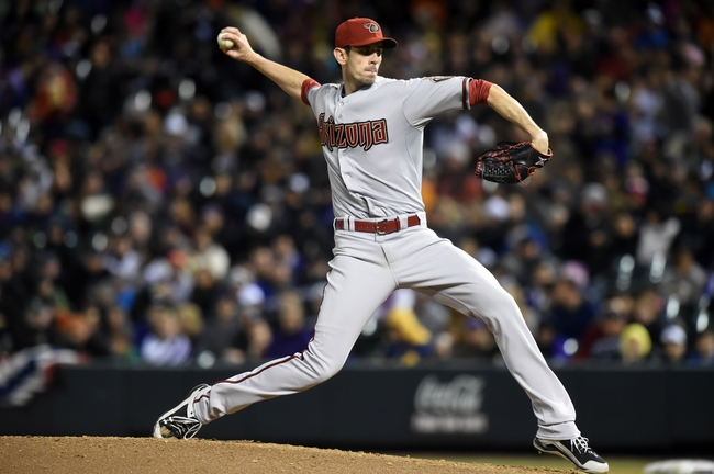 Apr 5, 2014; Denver, CO, USA; Arizona Diamondbacks starting pitcher Brandon McCarthy (32) pitches in the sixth inning against the Colorado Rockies at Coors Field. The Rockies defeated the Diamondbacks 9-4. Mandatory Credit: Ron Chenoy-USA TODAY Sports