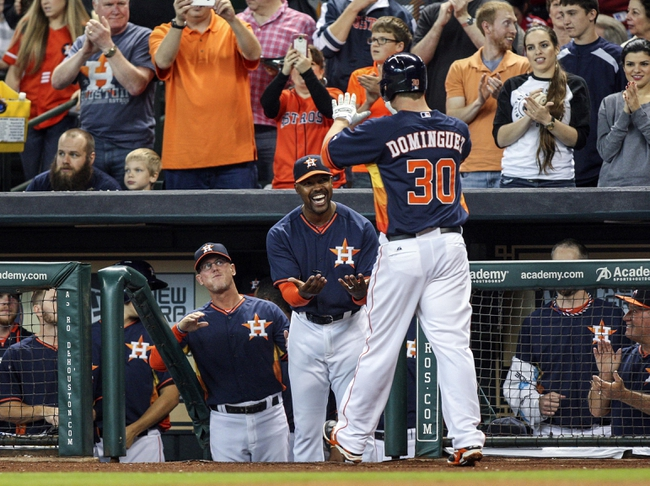 Apr 6, 2014; Houston, TX, USA; Houston Astros third baseman Matt Dominguez (30) is congratulated by manager Bo Porter (16) after hitting a home run during the second inning against the Los Angeles Angels at Minute Maid Park. Mandatory Credit: Troy Taormina-USA TODAY Sports