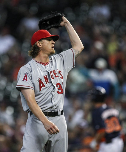 Apr 6, 2014; Houston, TX, USA; Los Angeles Angels starting pitcher Jered Weaver (36) reacts after giving up  a home run during the second inning as Houston Astros third baseman Matt Dominguez (30) rounds the bases at Minute Maid Park. Mandatory Credit: Troy Taormina-USA TODAY Sports