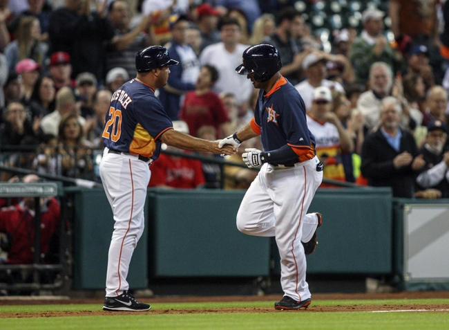 Apr 6, 2014; Houston, TX, USA; Houston Astros first baseman Jesus Guzman (14) is congratulated by third base coach Pat Listach (20) after hitting a home run during the fourth inning against the Los Angeles Angels at Minute Maid Park. Mandatory Credit: Troy Taormina-USA TODAY Sports