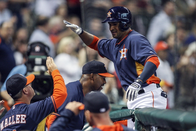 Apr 6, 2014; Houston, TX, USA; Houston Astros first baseman Jesus Guzman (14) is congratulated after hitting a home run during the fourth inning against the Los Angeles Angels at Minute Maid Park. Mandatory Credit: Troy Taormina-USA TODAY Sports