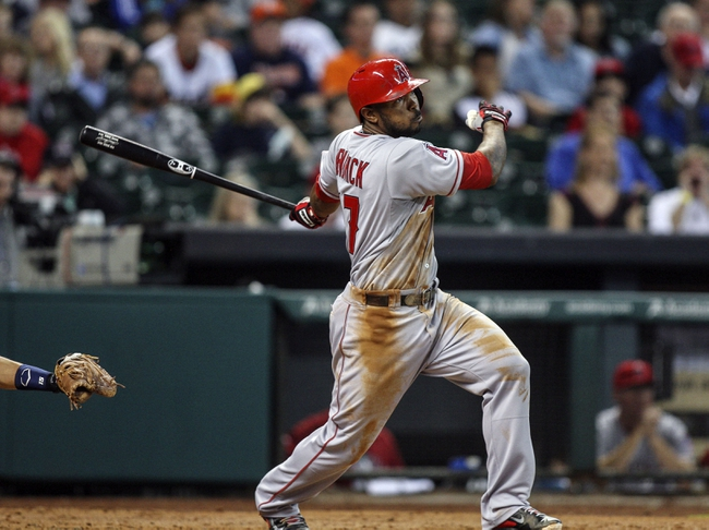 Apr 6, 2014; Houston, TX, USA; Los Angeles Angels second baseman Howie Kendrick (47) gets a base hit during the fifth inning against the Houston Astros at Minute Maid Park. Mandatory Credit: Troy Taormina-USA TODAY Sports