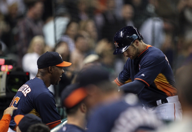 Apr 6, 2014; Houston, TX, USA; Houston Astros center fielder Alex Presley (8) is congratulated by manager Bo Porter (16) after hitting a home run during the fifth inning against the Los Angeles Angels at Minute Maid Park. Mandatory Credit: Troy Taormina-USA TODAY Sports