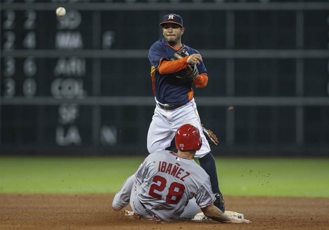 Apr 6, 2014; Houston, TX, USA; Los Angeles Angels designated hitter Raul Ibanez (28) is out at second as Houston Astros second baseman Jose Altuve (27) throws to first base during the seventh inning at Minute Maid Park. Mandatory Credit: Troy Taormina-USA TODAY Sports