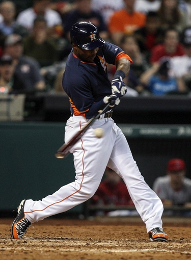 Apr 6, 2014; Houston, TX, USA; Houston Astros right fielder L.J. Hoes (28) gets a base hit during the seventh inning against the Los Angeles Angels at Minute Maid Park. Mandatory Credit: Troy Taormina-USA TODAY Sports