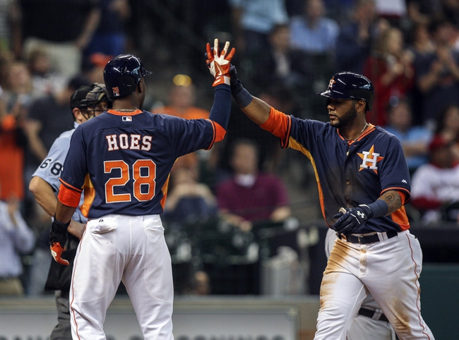 Apr 6, 2014; Houston, TX, USA; Houston Astros shortstop Jonathan Villar (6) is congratulated by right fielder L.J. Hoes (28) after hitting a home run during the seventh inning against the Los Angeles Angels at Minute Maid Park. Mandatory Credit: Troy Taormina-USA TODAY Sports