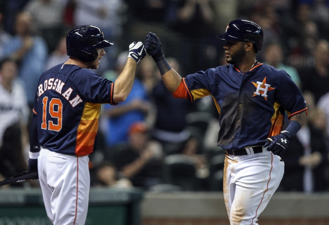 Apr 6, 2014; Houston, TX, USA; Houston Astros shortstop Jonathan Villar (6) is congratulated by left fielder Robbie Grossman (19) after hitting a home run during the seventh inning against the Los Angeles Angels at Minute Maid Park. Mandatory Credit: Troy Taormina-USA TODAY Sports