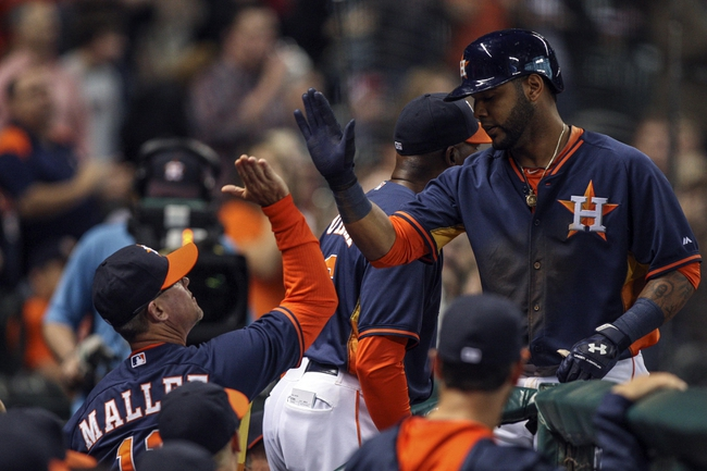 Apr 6, 2014; Houston, TX, USA; Houston Astros shortstop Jonathan Villar (6) is congratulated after hitting a home run during the seventh inning against the Los Angeles Angels at Minute Maid Park. Mandatory Credit: Troy Taormina-USA TODAY Sports