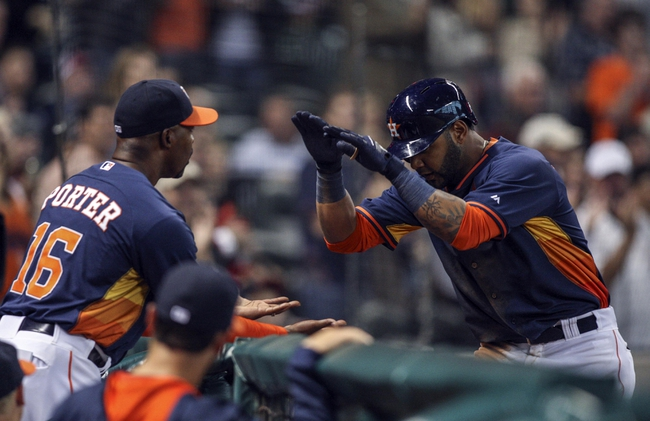 Apr 6, 2014; Houston, TX, USA; Houston Astros shortstop Jonathan Villar (6) is congratulated by manager Bo Porter (16) after hitting a home run during the seventh inning against the Los Angeles Angels at Minute Maid Park. Mandatory Credit: Troy Taormina-USA TODAY Sports