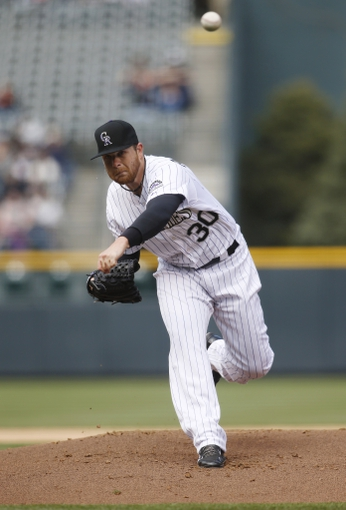 Apr 6, 2014; Denver, CO, USA; Colorado Rockies pitcher Brett Anderson (30) delivers a pitch during the first inning against the Arizona Diamondbacks at Coors Field. Mandatory Credit: Chris Humphreys-USA TODAY Sports