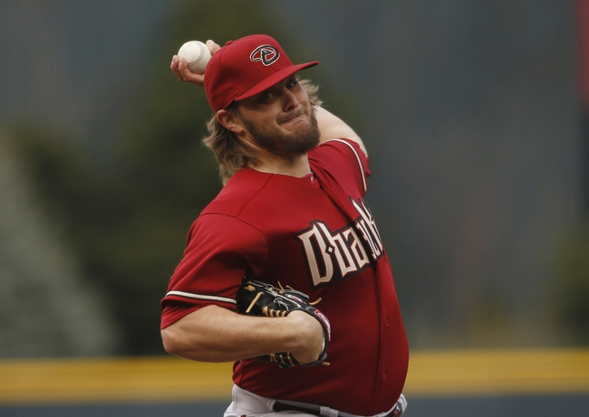 Apr 6, 2014; Denver, CO, USA; Arizona Diamondbacks starting pitcher Wade Miley (36) delivers a pitch during the first inning against the Colorado Rockies at Coors Field. . Mandatory Credit: Chris Humphreys-USA TODAY Sports