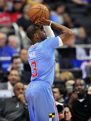 April 6, 2014; Los Angeles, CA, USA; Los Angeles Clippers guard Chris Paul (3) shoots a three point basket against the Los Angeles Lakers during the first half at Staples Center. Mandatory Credit: Gary A. Vasquez-USA TODAY Sports