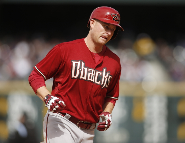 Apr 6, 2014; Denver, CO, USA; Arizona Diamondbacks left fielder Mark Trumbo (15) runs the bases after hitting a home run during the fifth inning against the Colorado Rockies at Coors Field. Mandatory Credit: Chris Humphreys-USA TODAY Sports