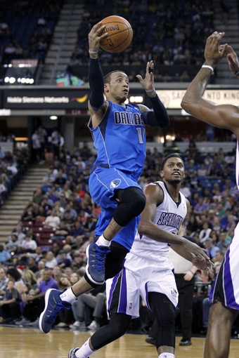 Apr 6, 2014; Sacramento, CA, USA; Dallas Mavericks guard Monta Ellis (11) attempts a shot against the Sacramento Kings in the second quarter at Sleep Train Arena. Mandatory Credit: Cary Edmondson-USA TODAY Sports