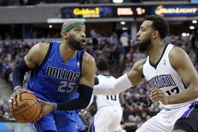Apr 6, 2014; Sacramento, CA, USA; Dallas Mavericks guard Vince Carter (25) looks to shoot the ball over Sacramento Kings forward Derrick Williams (13) in the second quarter at Sleep Train Arena. Mandatory Credit: Cary Edmondson-USA TODAY Sports