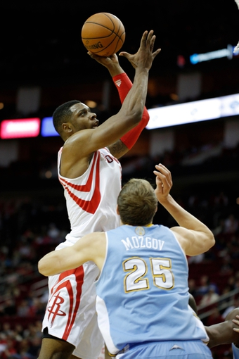 Apr 6, 2014; Houston, TX, USA; Houston Rockets forward Terrence Jones (6) shoots the ball over Denver Nuggets center Timofey Mozgov (25) during the first quarter at Toyota Center. Mandatory Credit: Andrew Richardson-USA TODAY Sports