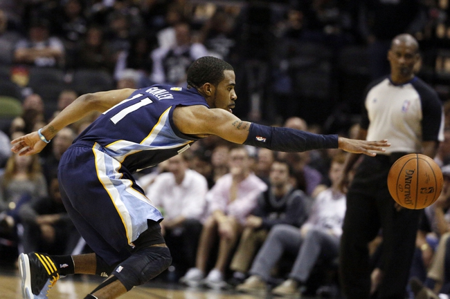 Apr 6, 2014; San Antonio, TX, USA; Memphis Grizzlies guard Mike Conley (11) attempts to save a ball going out of bounds during the first half against the San Antonio Spurs at AT&T Center. Mandatory Credit: Soobum Im-USA TODAY Sports