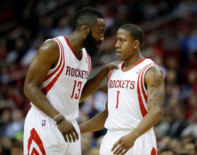 Apr 6, 2014; Houston, TX, USA; Houston Rockets guard James Harden (13) speaks with guard Isaiah Canaan (1) during the first quarter against the Denver Nuggets at Toyota Center. Mandatory Credit: Andrew Richardson-USA TODAY Sports
