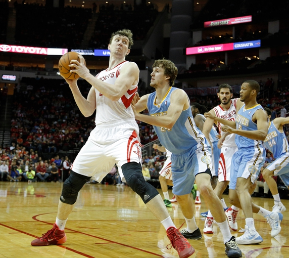 Apr 6, 2014; Houston, TX, USA; Houston Rockets center Omer Asik (3) is defended by Denver Nuggets forward Jan Vesely (24) during the second quarter at Toyota Center. Mandatory Credit: Andrew Richardson-USA TODAY Sports