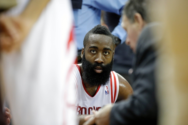 Apr 6, 2014; Houston, TX, USA; Houston Rockets guard James Harden (13) listens during a timeout during the second quarter against the Denver Nuggets at Toyota Center. Mandatory Credit: Andrew Richardson-USA TODAY Sports