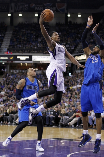 Apr 6, 2014; Sacramento, CA, USA; Sacramento Kings forward Rudy Gay (8) attempts a shot against the Dallas Mavericks in the fourth quarter at Sleep Train Arena. The Mavericks defeated the Kings 93-91. Mandatory Credit: Cary Edmondson-USA TODAY Sports