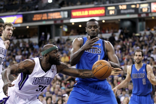 Apr 6, 2014; Sacramento, CA, USA; Dallas Mavericks center Samuel Dalembert (1) and Sacramento Kings forward Reggie Evans (30) battle for control of a loose ball in the third quarter at Sleep Train Arena. The Mavericks defeated the Kings 93-91. Mandatory Credit: Cary Edmondson-USA TODAY Sports