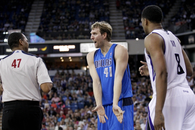 Apr 6, 2014; Sacramento, CA, USA; Dallas Mavericks forward Dirk Nowitzki (41) looks for a foul call after Sacramento Kings forward Rudy Gay (8) made a basket in the third quarter at Sleep Train Arena. The Mavericks defeated the Kings 93-91. Mandatory Credit: Cary Edmondson-USA TODAY Sports