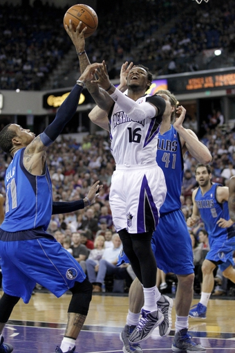 Apr 6, 2014; Sacramento, CA, USA; Sacramento Kings guard Ben McLemore (16) attempts a shot against the Dallas Mavericks in the third quarter at Sleep Train Arena. The Mavericks defeated the Kings 93-91. Mandatory Credit: Cary Edmondson-USA TODAY Sports