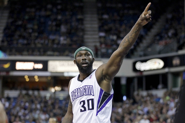 Apr 6, 2014; Sacramento, CA, USA; Sacramento Kings forward Reggie Evans (30) looks towards a referee after the ball went out of bounds against the Dallas Mavericks in the third quarter at Sleep Train Arena. The Mavericks defeated the Kings 93-91. Mandatory Credit: Cary Edmondson-USA TODAY Sports