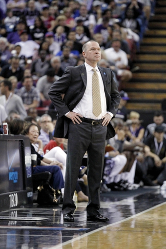 Apr 6, 2014; Sacramento, CA, USA; Sacramento Kings head coach Michael Malone watches action against the Dallas Mavericks in the third quarter at Sleep Train Arena. The Mavericks defeated the Kings 93-91. Mandatory Credit: Cary Edmondson-USA TODAY Sports