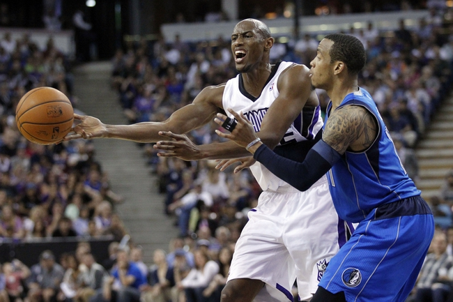 Apr 6, 2014; Sacramento, CA, USA; Sacramento Kings forward Travis Outlaw (25) passes the ball away from Dallas Mavericks guard Monta Ellis (11) in the fourth quarter at Sleep Train Arena. The Mavericks defeated the Kings 93-91. Mandatory Credit: Cary Edmondson-USA TODAY Sports