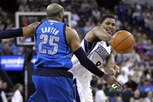 Apr 6, 2014; Sacramento, CA, USA; Sacramento Kings forward Rudy Gay (8) passes the ball around Dallas Mavericks guard Vince Carter (25) in the fourth quarter at Sleep Train Arena. The Mavericks defeated the Kings 93-91. Mandatory Credit: Cary Edmondson-USA TODAY Sports