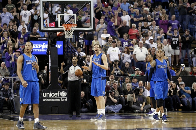Apr 6, 2014; Sacramento, CA, USA; Dallas Mavericks forward Dirk Nowitzki (41) looks towards the team bench after missing a free throw against the Sacramento Kings late in the fourth quarter at Sleep Train Arena. The Mavericks defeated the Kings 93-91. Mandatory Credit: Cary Edmondson-USA TODAY Sports