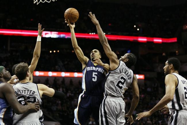 Apr 6, 2014; San Antonio, TX, USA; Memphis Grizzlies guard Courtney Lee (5) shoots as San Antonio Spurs forward Kawhi Leonard (2) defends during the second half at AT&T Center. Mandatory Credit: Soobum Im-USA TODAY Sports