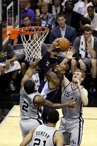Apr 6, 2014; San Antonio, TX, USA; Memphis Grizzlies forward James Johnson (3) shoots as San Antonio Spurs forward Kawhi Leonard (2)  defends during the second half at AT&T Center. The Spurs won 112-92. Mandatory Credit: Soobum Im-USA TODAY Sports