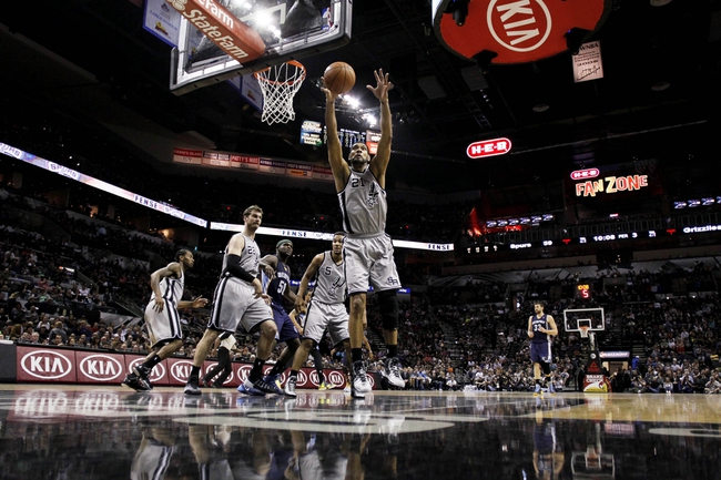 Apr 6, 2014; San Antonio, TX, USA; San Antonio Spurs forward Tim Duncan (21) reaches for a rebound during the second half against the Memphis Grizzlies at AT&T Center. The Spurs won 112-92. Mandatory Credit: Soobum Im-USA TODAY Sports