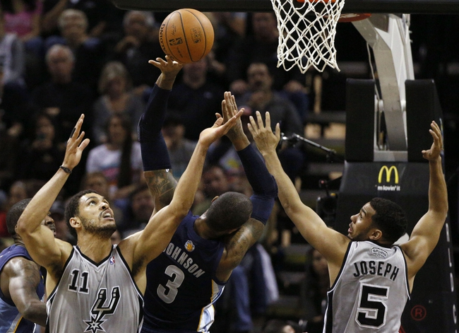 Apr 6, 2014; San Antonio, TX, USA; San Antonio Spurs forward Jeff Ayres (11) and Memphis Grizzlies forward James Johnson (3) battle for a rebound during the first half at AT&T Center. Mandatory Credit: Soobum Im-USA TODAY Sports