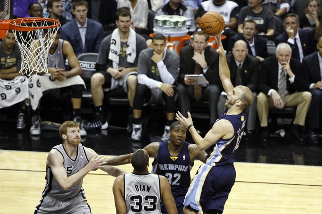 Apr 6, 2014; San Antonio, TX, USA; Memphis Grizzlies guard Nick Calathes (12) shoots the ball during the second half against the San Antonio Spurs at AT&T Center. The Spurs won 112-92. Mandatory Credit: Soobum Im-USA TODAY Sports